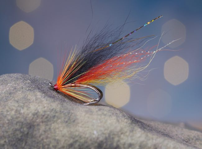 If you're new to Scottish salmon fishing and have rightfully booked a professional Scottish salmon fishing guide to navigate you to the salmon river hots spots and be sure to also let him advise you on which salmon fly patterns are most effective to use.